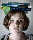 Woman with textbooks on her head